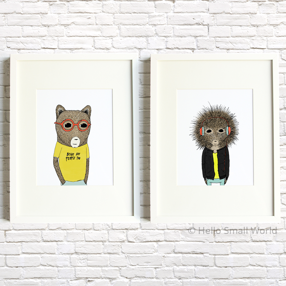 quirky animal framed prints on brick wall