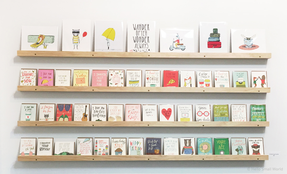 greeting card wall at hello small world gallery