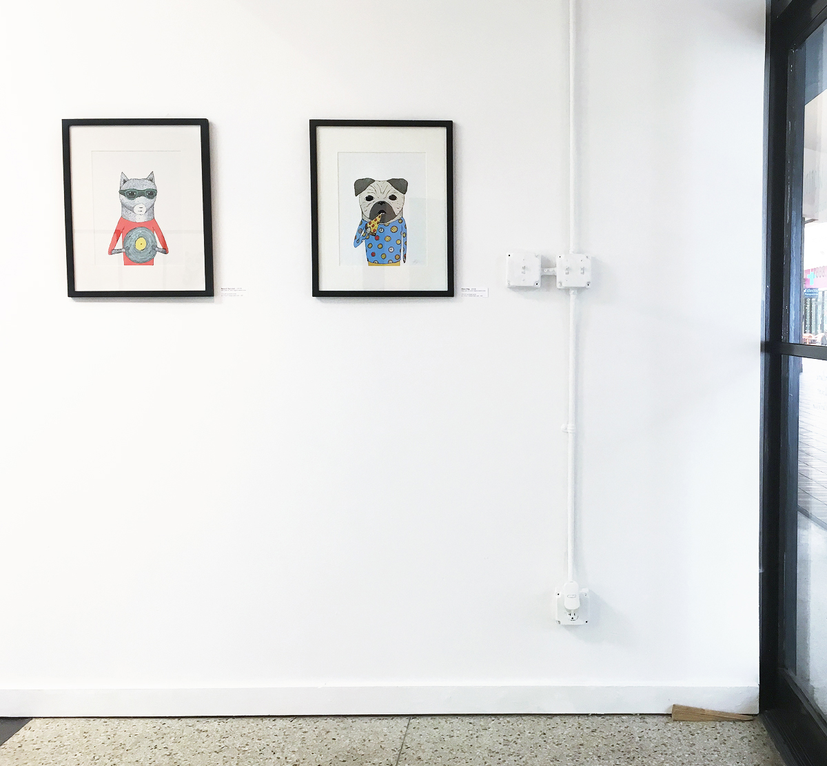 framed pizza pug and record raccoon prints at hello small world gallery