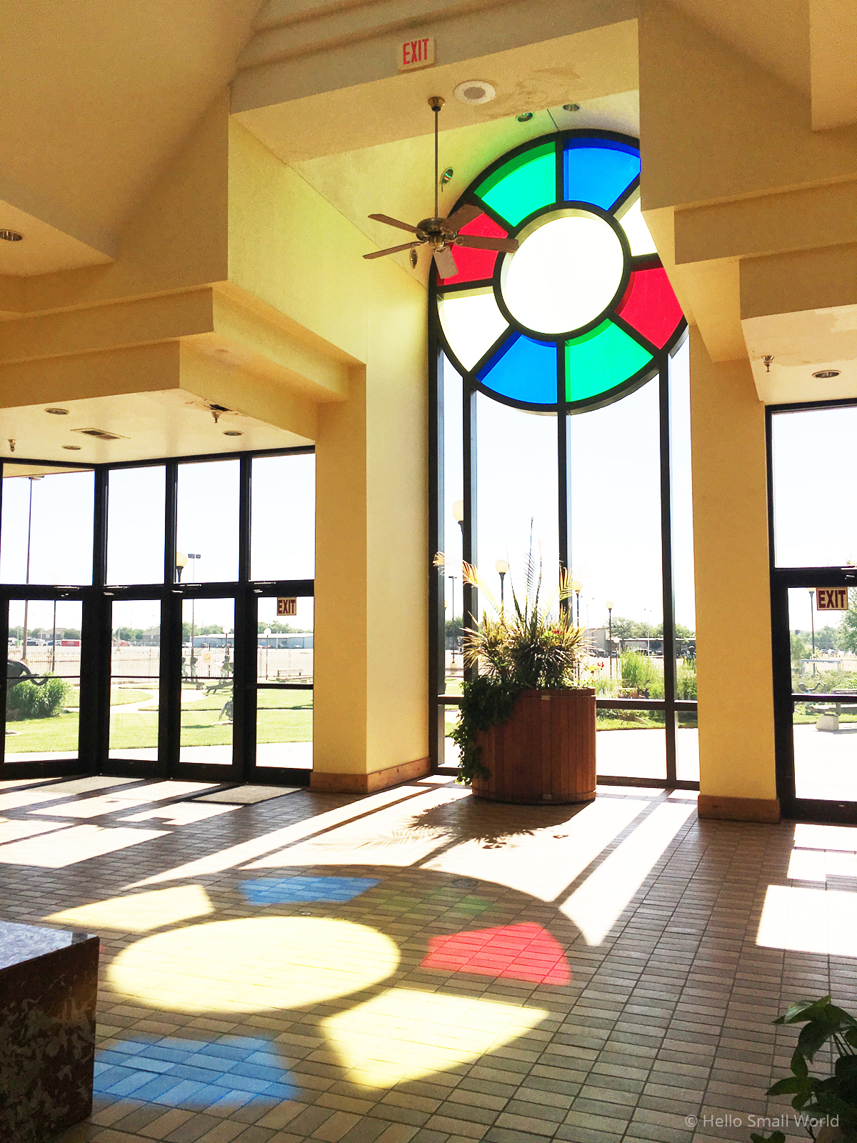 sunset art center in amarillo texas interior view through stainglass window with sun shining in
