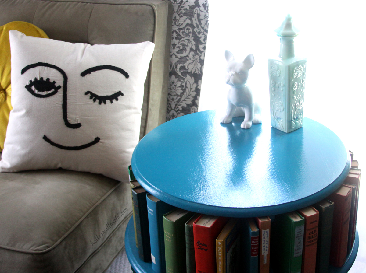 thrifted furniture and winky face urban outfitters pillow for affordable decor styling