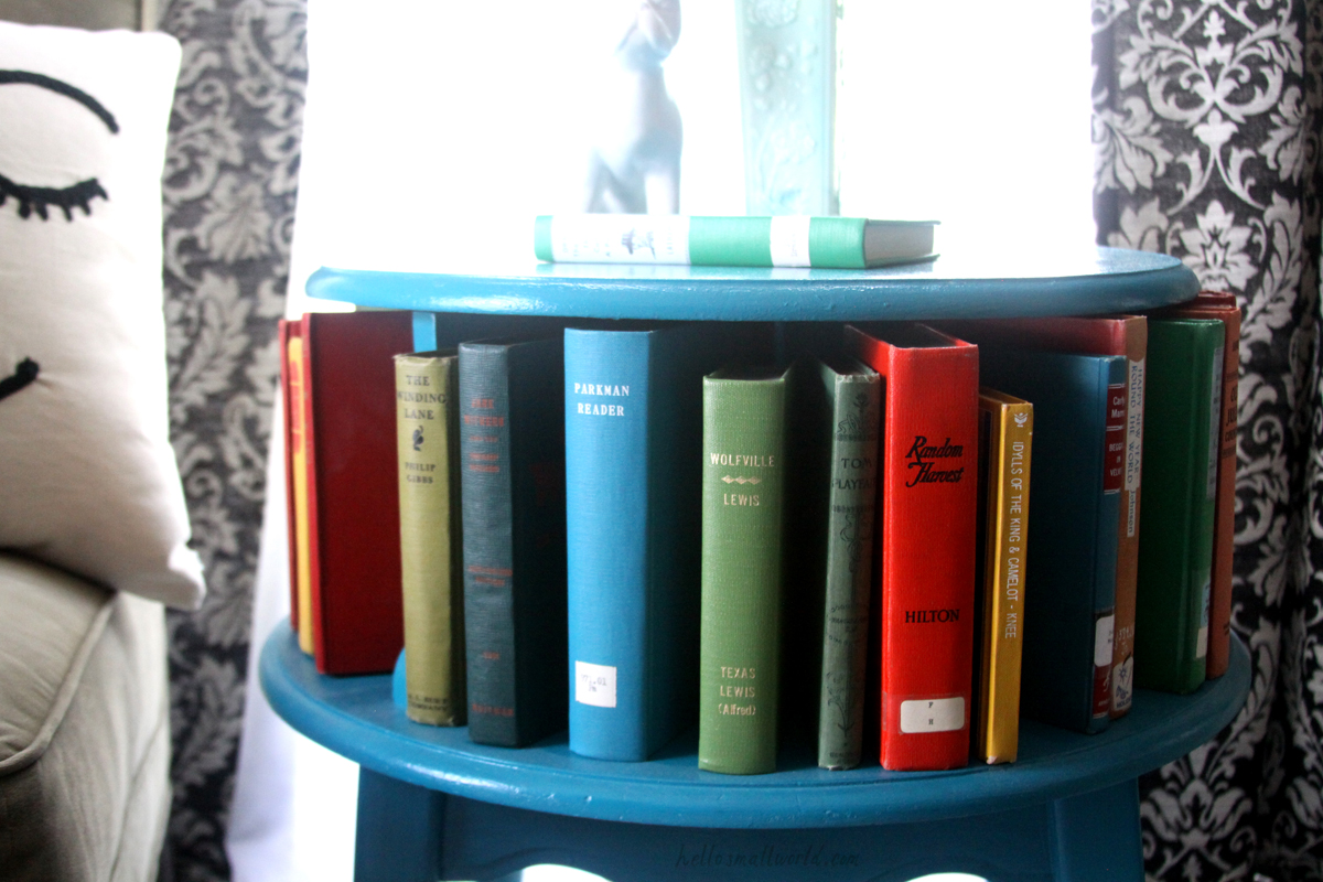 vintage books displayed on a round book table