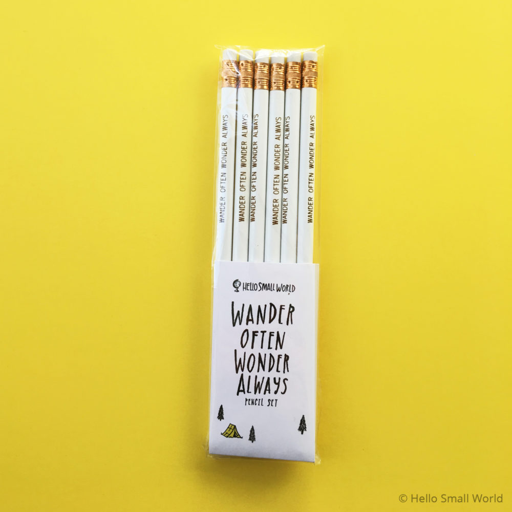 wander often wonder always pencil white with gold in package on yellow