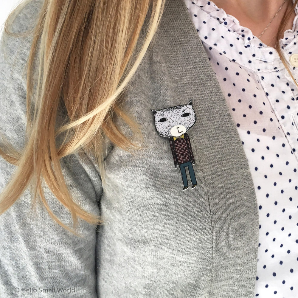 bowtie brooch on grey cardigan lifestly pic