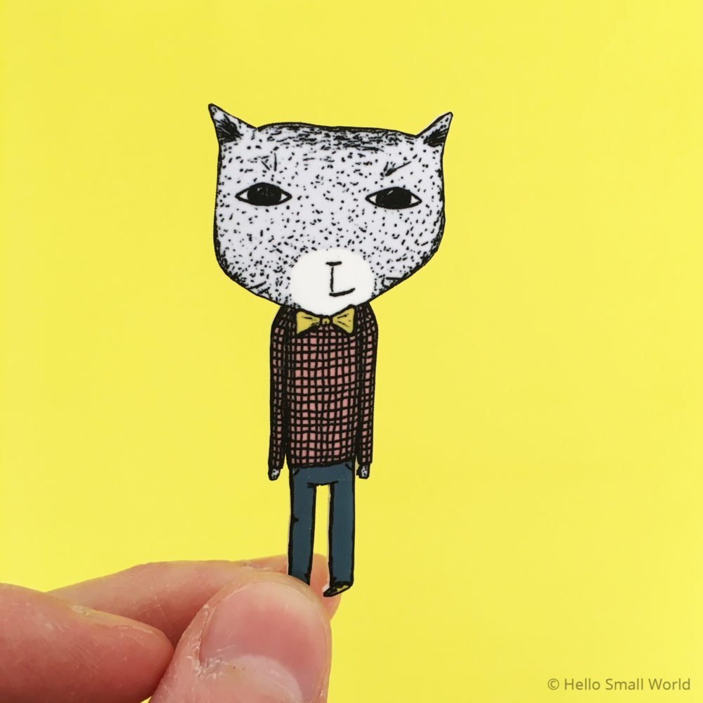 bowtie cat brooch on yellow