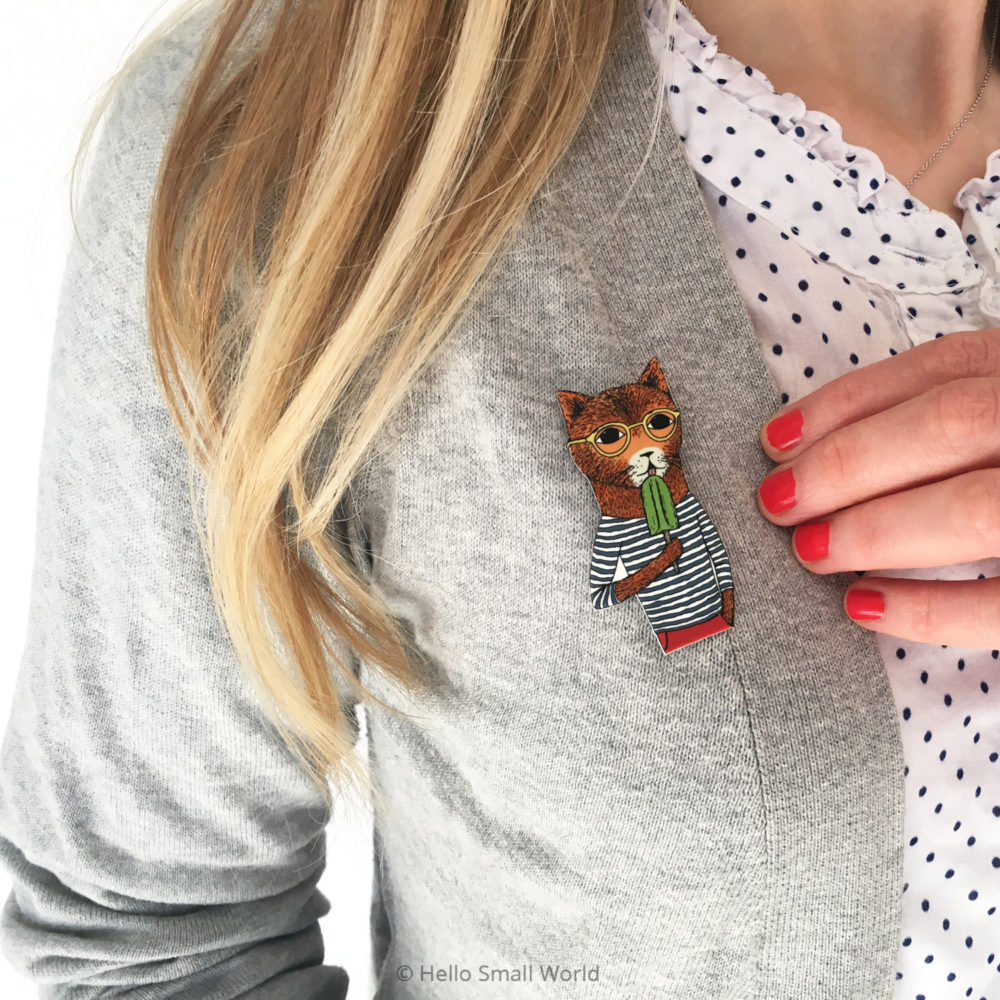 cool cat brooch on grey cardigan lifestyle image