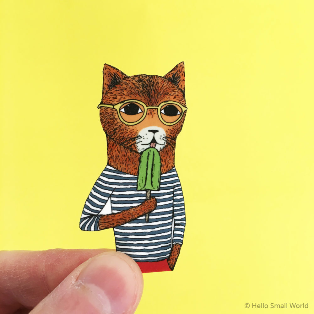 cool cat brooch on yellow