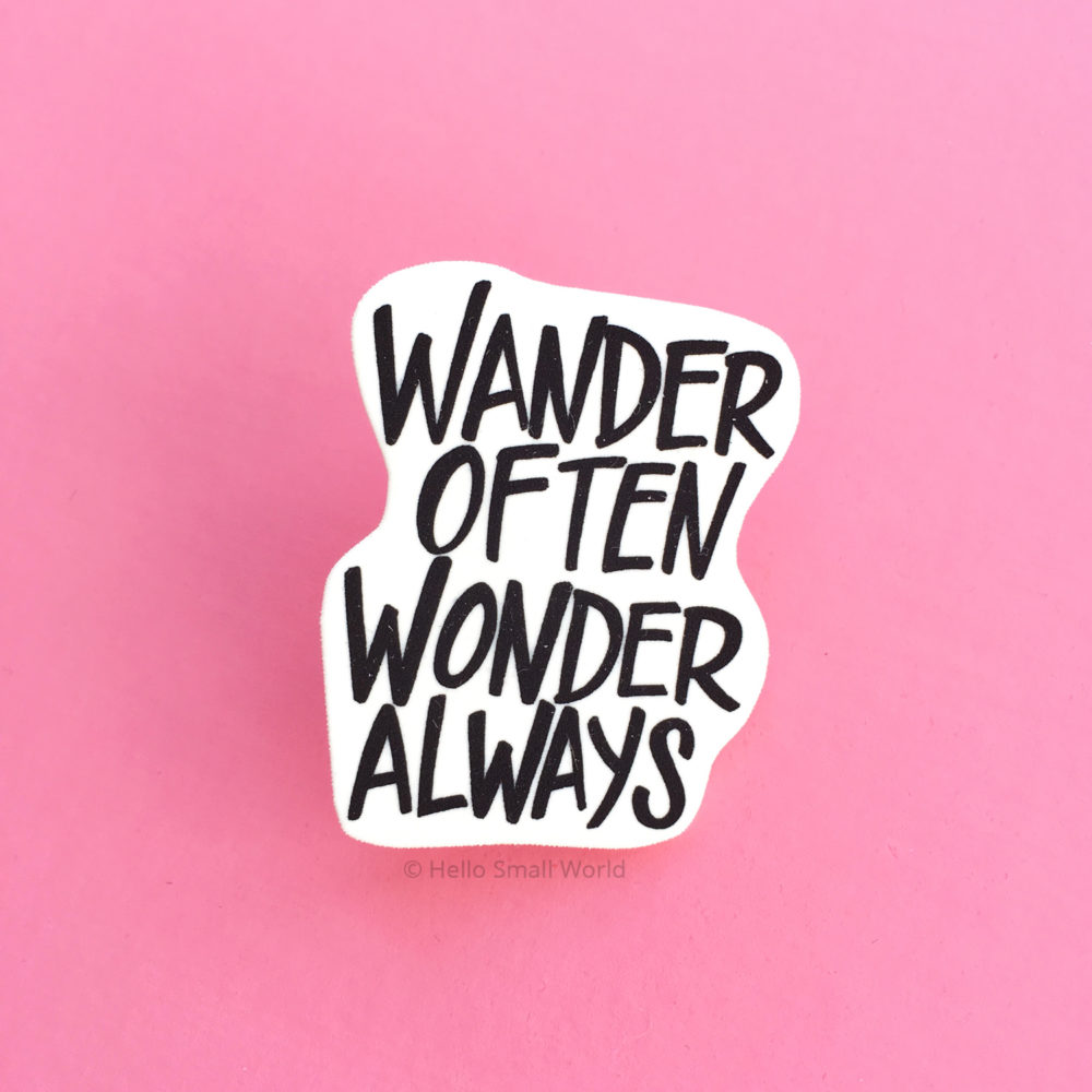 wander often wonder always brooch on pink